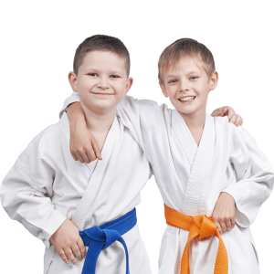 two young boys in martial arts uniforms
