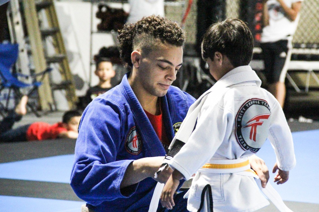 Team Tooke Instructor helping a student
