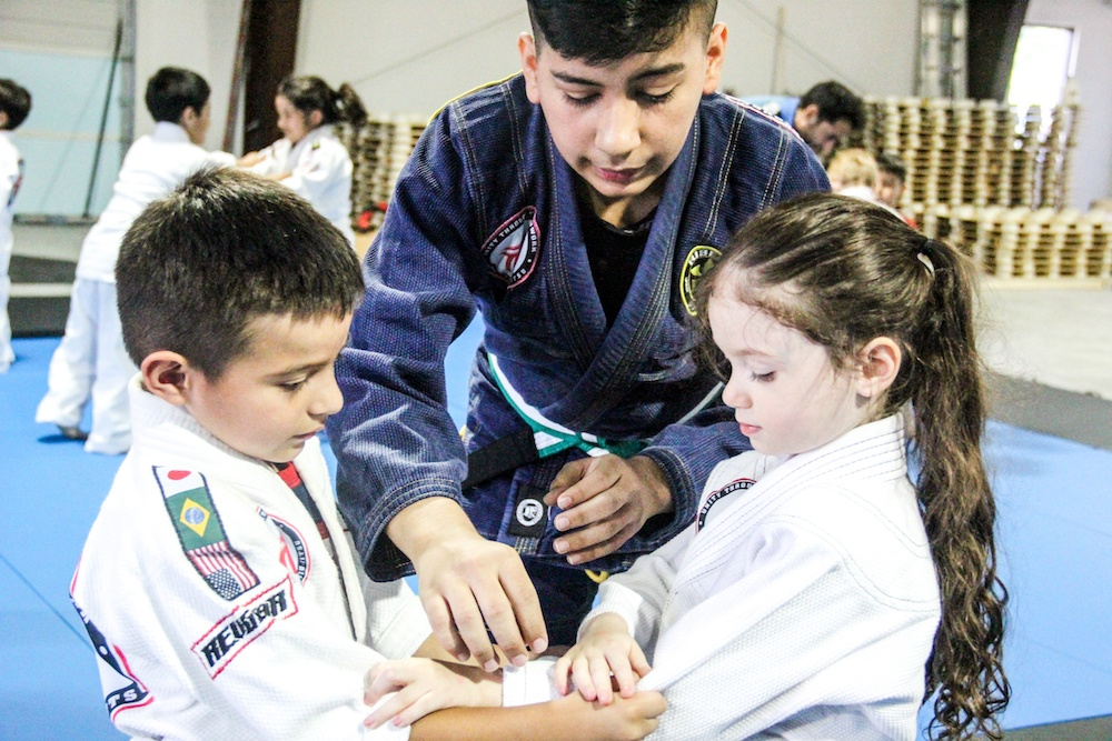 two kids learning Brazilain Jiu-Jitsu